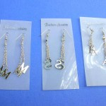wholesale fashion earrings. Long silver high fashion earrings with alphabet letter charms.