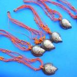 wholesale imitation amber necklaces. Snail sea shell pendant on orange pink multi string beaded necklace