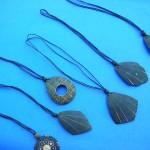 wholesale amber necklaces. Summer coconut pendant design on black string necklace
