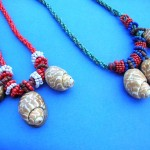 Jewelry Broochs pendants wholesale. Large indonesian designed snail shell pendant and beaded string necklace.