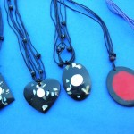 necklace bali art. Hot spring seashell chip in resin designed pendant on multi string necklace.