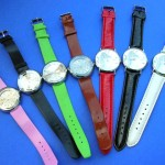 wholesale wrist watches. Fun theme clock face design on ladies watch, with colored imitation leather band.