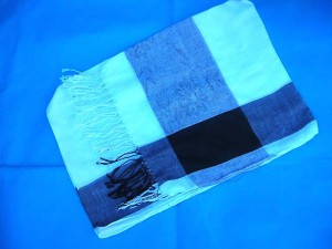 Shawls wholesale. One color only, white background with black on four edges.