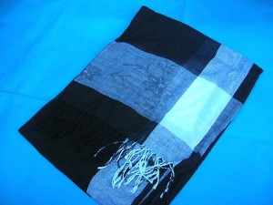 wholesale shawl. One color only, black background with white and grey on four edges.
