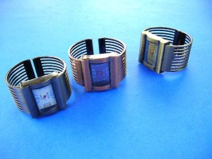 wholesale fashion watches. Classy bronze copper watch with multi band bangle bracelet and large rectangle clock face.
