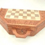 wholesale chess set. Handcarved wooden chess sets in octagon shape, detailed carvings on sides and top.