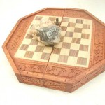 wholesale chess collection. Handcarved wooden chess sets in octagon shape, detailed carvings on sides and top.