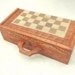 chess boards. Handcarved wooden chess sets in square shape, detailed carvings on sides and top.