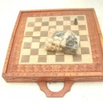 wooden chess set. Handcarved wooden chess sets in square shape, detailed carvings on sides and top.