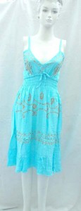 Deep V rayon sundress with embroidery. Adjustable shoulder stripes. Elasticised smocked waist.