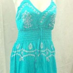 Wholesale bali dresses. Deep V rayon sundress with embroidery. Adjustable shoulder stripes. Elasticised smocked waist.