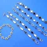 wholesale bracelets. Crafted enamel charms on silver chain bracelet.