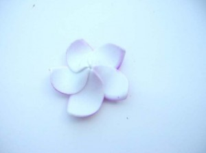 wholesale hats. Stand along foam plumeria flowers in assorted colors. Great as floating decoration on water. Please let us know by email or phone, if you want single color or assorted mix color. If not specified, we will give you mixed colors.
