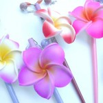 Wholesale Organic Body Jewelry.Foam plumeria flower hair picks in assorted tropical colors and Japanese lady paintings. Handmade handpainted in Bali Indonesia.