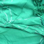wholesale sarong bali. forest green plain sarong with embroidery.