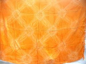 Indonesia Exporter. tie-dye sarong orange yellow burst in diamond pattern.