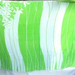 Wholesale lava lava. green white sarong with florals on two corners.