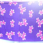 wholesale warehouse clothing. awaiian plumeria floral sarong in bluish purple and pink.