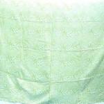 hippie fashion. light green and white animal skin printed sarong.