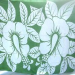 wholesale sarong. green and white Hawaiian long sarong with large hibiscus flowers.