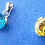wholesale sterling silver necklaces. Round elegant cut yellow or turquoise cubic zirconia sterling silver pendant, randomly picked by our warehouse staffs.