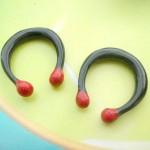 wholesale tribal earrings. gauges earrings tunnels horn earlets with 2 red balls.