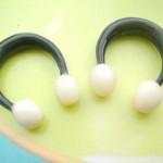 bali wooden earrings earlets. gauges earrings tunnels horn earlets with 2 white balls.