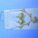 Silver Rings Earrings Bracelets Necklaces Wholesaler. Antique style earrings and necklace set in diamond design with silver chain and faux turquoise gems.