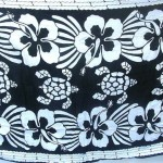 batik sarongs. balck and white turtles and hibiscus flower unisex sarongs.