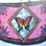 Wholesale women's clothing. pink sarong with large butterfly in diamond center.