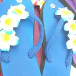 wholesale summer sandals. assorted colors rubber sandal with three foam plumeria flowers.