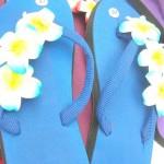 flip flop sandal wholesale. assorted colors rubber sandal with three foam plumeria flowers.