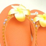 wholesale beach footwear. assorted colors rubber sandal with foam plumeria flower, beads, and sequins.