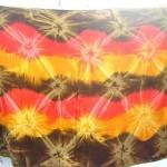 wholesale sarongs apparel. diamond wave orange brown red tie-dye burst colourful sarongs.