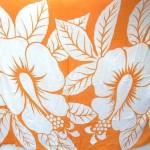 wholesale sarong clothing. huge hibiscus flower orange sarong.