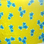 Sarong wholesaler. yellow Bali java stamped sarong with blue plumeria flowers.