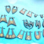Wholesale organic wood jewelry. assorted design of wood peg earrings.