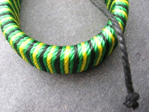 adjustable size green yellow black thread wrap around leather bracelet