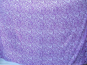 Bali sarong small purple swirls on white background