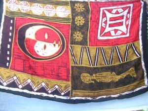 trible mask sarong red and brown