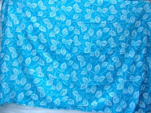 blue sarong with small white leaf