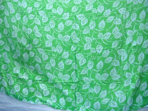 silk screen printed sarong leaves on green and pink background assorted
