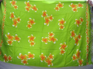 green sarong with orange plumeria flowers