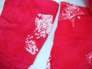 monocolor red sarong screen printings with leaves, sun, dolphin, seashell, palm leaves etc tropical designs
