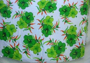 green hibiscus flower Indonesian sarong on white background