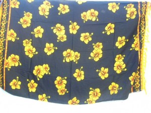 yellow hibiscus flower Indonesian sarong on black background