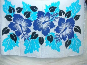 blue hibiscus flower Indonesian sarong on white background