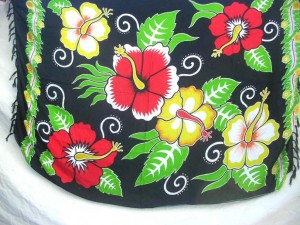 painted hibiscus sarong tropical dress on black grounground