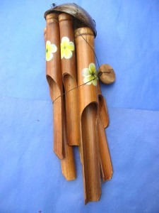 medium size yellow hibiscus flower painting bamboo wind chime made in Bali Indonesia 17 to 18 inches long from top coconut to end of the longest bamboo pipe