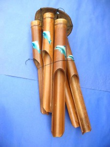 medium size dolphin painting bamboo wind chime made in Bali Indonesia 17 to 18 inches long from top coconut to end of the longest bamboo pipe
